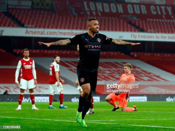 Manchester City's Brazilian striker Gabriel Jesus celebrates scoring during the English League Cup quarter final football match between Arsenal and...