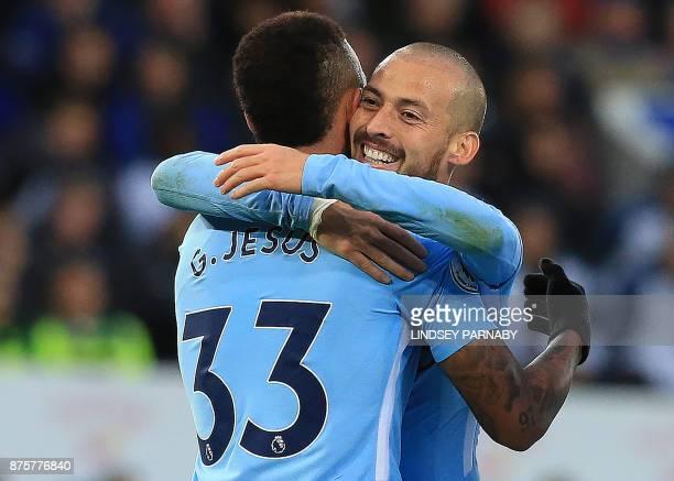 Manchester City's Brazilian striker Gabriel Jesus celebrates scoring the opening goal with Manchester City's Spanish midfielder David Silva during...