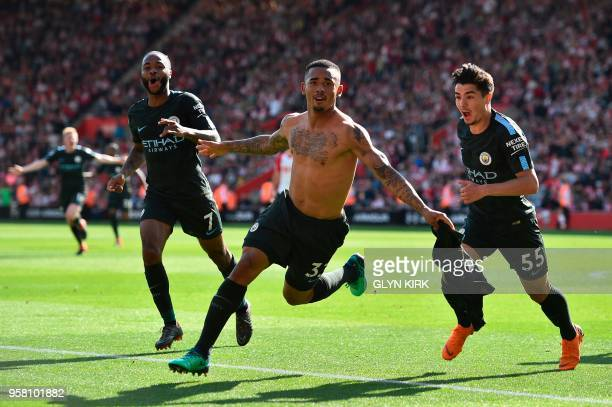 Manchester City's Brazilian striker Gabriel Jesus celebrates scoring the opening goal during the English Premier League football match between...