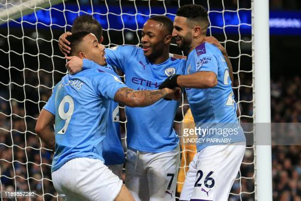 Manchester City's Brazilian striker Gabriel Jesus celebrates with teammates after scoring their third goal during the English Premier League football...