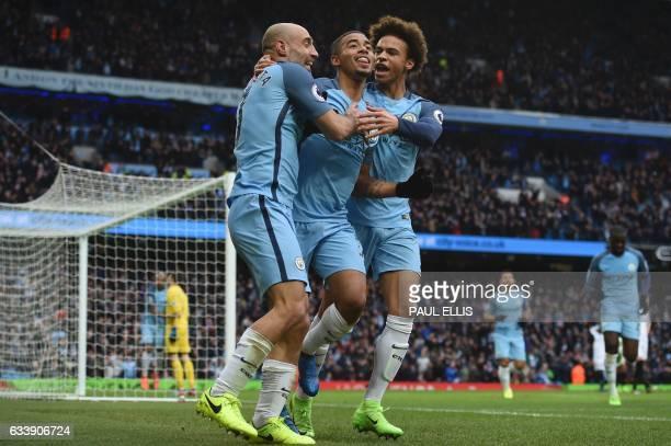 Manchester City's Brazilian striker Gabriel Jesus celebrates with Manchester City's Argentinian defender Pablo Zabaleta and Manchester City's German...
