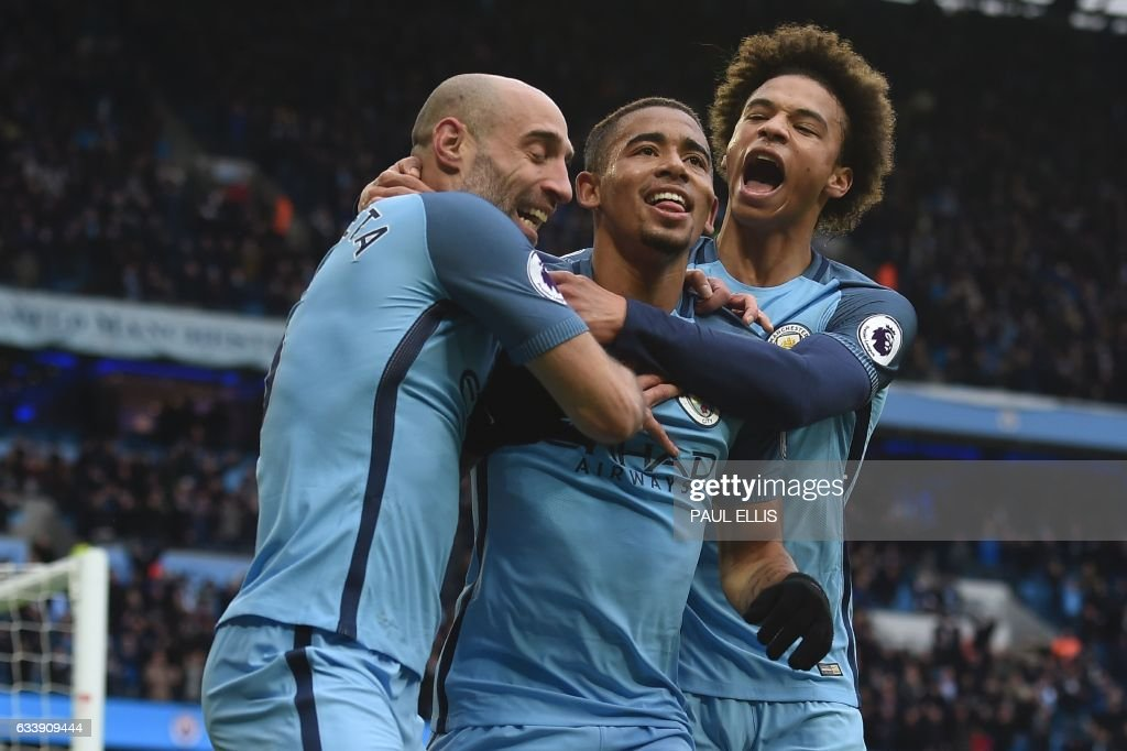 Manchester City's Brazilian striker Gabriel Jesus (C) celebrates with Manchester City's Argentinian defender Pablo Zabaleta (L) and Manchester City's German midfielder Leroy Sane (R) after scoring their late winning goal during the English Premier League football match between Manchester City and Swansea City at the Etihad Stadium in Manchester, north west England, on February 5, 2017. Manchester City won the game 2-1. / AFP / PAUL ELLIS / RESTRICTED TO EDITORIAL USE. No use with unauthorized audio, video, data, fixture lists, club/league logos or 'live' services. Online in-match use limited to 75 images, no video emulation. No use in betting, games or single club/league/player publications. /