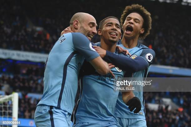Manchester City's Brazilian striker Gabriel Jesus celebrates with Manchester City's Argentinian defender Pablo Zabaleta and Manchester City's German...