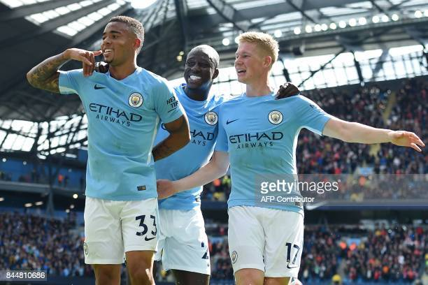 Manchester City's Brazilian striker Gabriel Jesus celebrates with Manchester City's French defender Benjamin Mendy and Manchester City's Belgian...