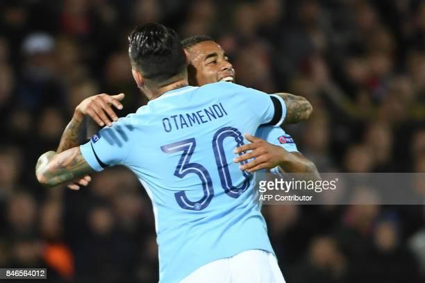 Manchester City's Brazilian striker Gabriel Jesus celebrates with Manchester City's Argentinian defender Nicolas Otamendi after scoring a goal during...