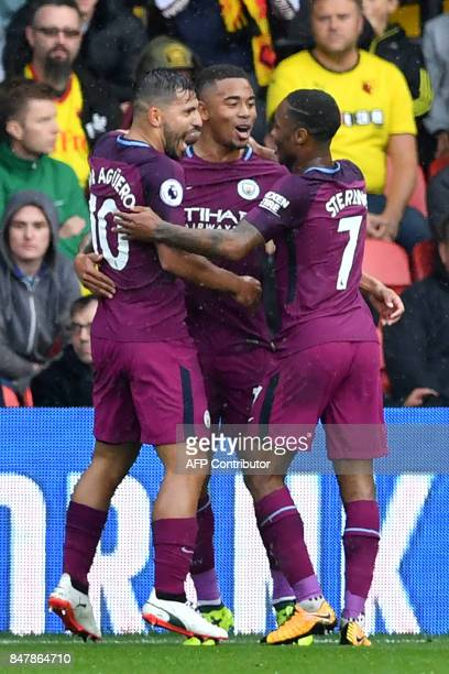 Manchester City's Brazilian striker Gabriel Jesus celebrates with Manchester City's Argentinian striker Sergio Aguero and Manchester City's English...