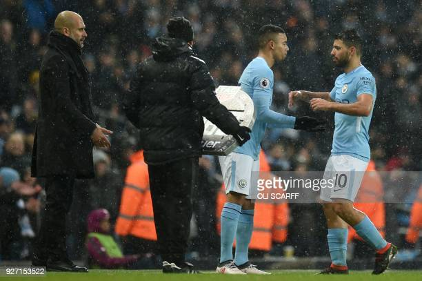 Manchester City's Brazilian striker Gabriel Jesus comes on for Manchester City's Argentinian striker Sergio Aguero as Manchester City's Spanish...