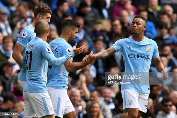 Manchester City's Brazilian striker Gabriel Jesus gestures to Manchester City's Argentinian striker Sergio Aguero after Aguero scores the opening...