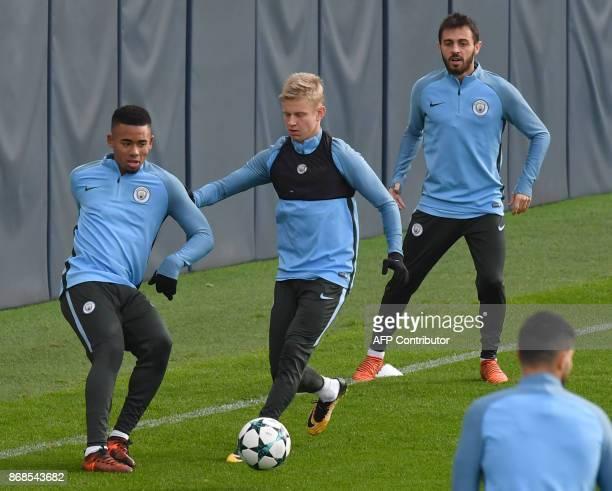 Manchester City's Brazilian striker Gabriel Jesus Manchester City's Ukrainian midfielder Oleksandr Zinchenko and Manchester City's Portuguese...
