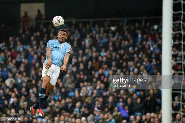 TOPSHOT Manchester City's Brazilian striker Gabriel Jesus misses with this headed attempt during the English FA Cup third round football match...