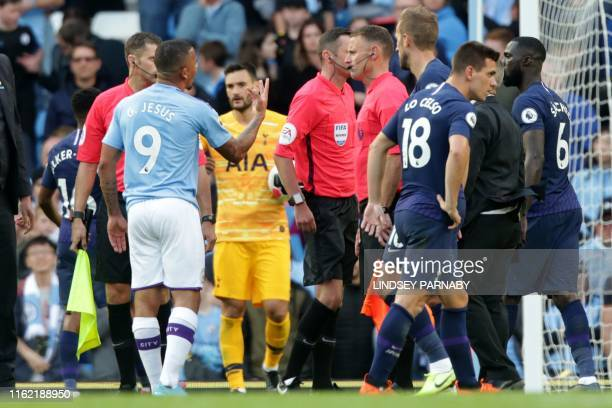 Manchester City's Brazilian striker Gabriel Jesus remonstrates with English referee Michael Oliver and the assistant referees after his goal was...