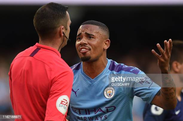 Manchester City's Brazilian striker Gabriel Jesus remonstrates with English referee Michael Oliver after his goal was dissallowed following a VAR...