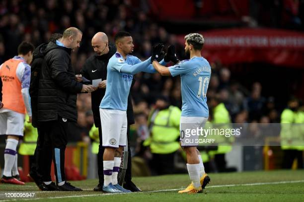 Manchester City's Brazilian striker Gabriel Jesus replaces Manchester City's Argentinian striker Sergio Aguero during the English Premier League...