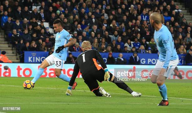Manchester City's Brazilian striker Gabriel Jesus scores the opening goal past Leicester City's Danish goalkeeper Kasper Schmeichel during the...