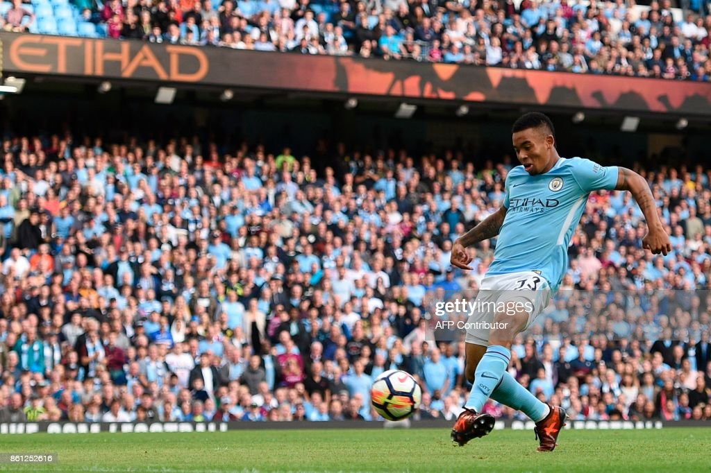 Manchester City's Brazilian striker Gabriel Jesus scores their fourth goal during the English Premier League football match between Manchester City and Stoke City at the Etihad Stadium in Manchester, north west England, on October 14, 2017. / AFP PHOTO / Oli SCARFF / RESTRICTED TO EDITORIAL USE. No use with unauthorized audio, video, data, fixture lists, club/league logos or 'live' services. Online in-match use limited to 75 images, no video emulation. No use in betting, games or single club/league/player publications. /