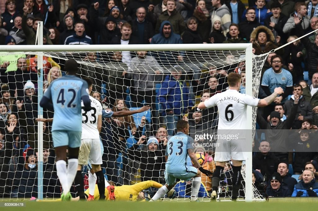 Manchester City's Brazilian striker Gabriel Jesus (2nd R) scores their late winning goal during the English Premier League football match between Manchester City and Swansea City at the Etihad Stadium in Manchester, north west England, on February 5, 2017. Manchester City won the game 2-1. / AFP / Oli SCARFF / RESTRICTED TO EDITORIAL USE. No use with unauthorized audio, video, data, fixture lists, club/league logos or 'live' services. Online in-match use limited to 75 images, no video emulation. No use in betting, games or single club/league/player publications. /