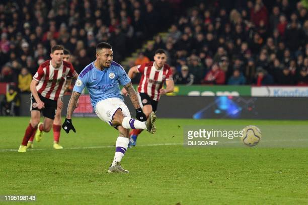 Manchester City's Brazilian striker Gabriel Jesus shoots from the penalty spot but has his shot saved during the English Premier League football...