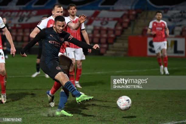 Manchester City's Brazilian striker Gabriel Jesus shoots to score their second goal during the English FA Cup fourth round football match between...