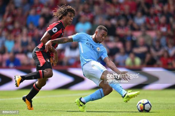 Manchester City's Brazilian striker Gabriel Jesus shoots to score their first goal during the English Premier League football match between...