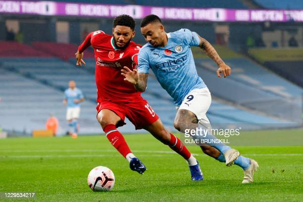 Manchester City's Brazilian striker Gabriel Jesus takes on Liverpool's English defender Joe Gomez during the English Premier League football match...
