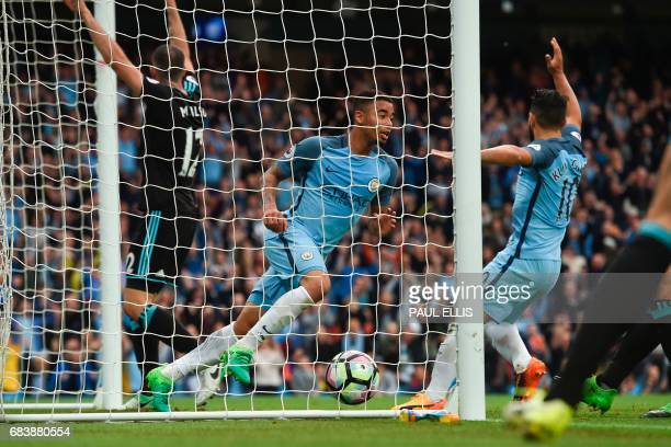 Manchester City's Brazilian striker Gabriel Jesus turns to celebrate after scoring the opening goal during the English Premier League football match...