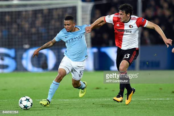 Manchester City's Brazilian striker Gabriel Jesus vies for the ball with Feyenoord's Dutch defender Eric Botteghin during the UEFA Champions League...