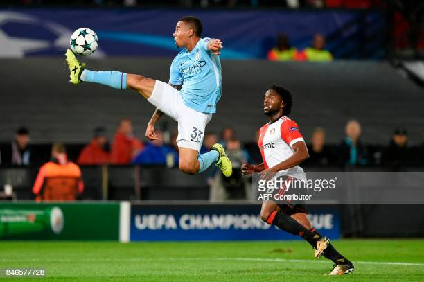 Manchester City's Brazilian striker Gabriel Jesus vies vies for the ball with Feyenoord's Dutch defender Miquel Nelom during the UEFA Champions...