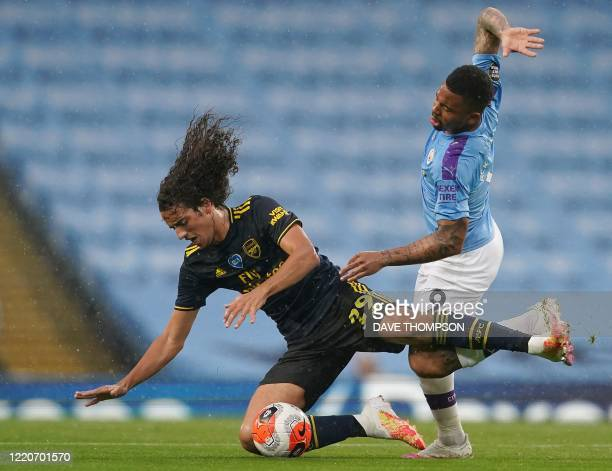 Manchester City's Brazilian striker Gabriel Jesus vies with Arsenal's French midfielder Matteo Guendouzi during the English Premier League football...