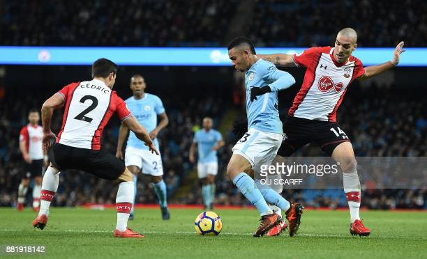 Manchester City's Brazilian striker Gabriel Jesus vies with Southampton's Germanborn Portuguese defender Cedric Soares and Southampton's Spanish...