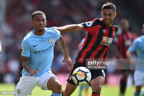 Manchester City's Brazilian striker Gabriel Jesus vies with Bournemouth's South Africanborn English midfielder Andrew Surman during the English...