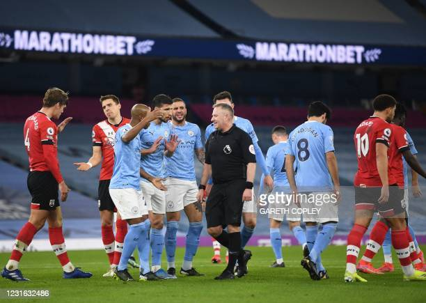 Manchester City's Brazilian striker players argue with referee Jonathon Moss during the English Premier League football match between Manchester City...