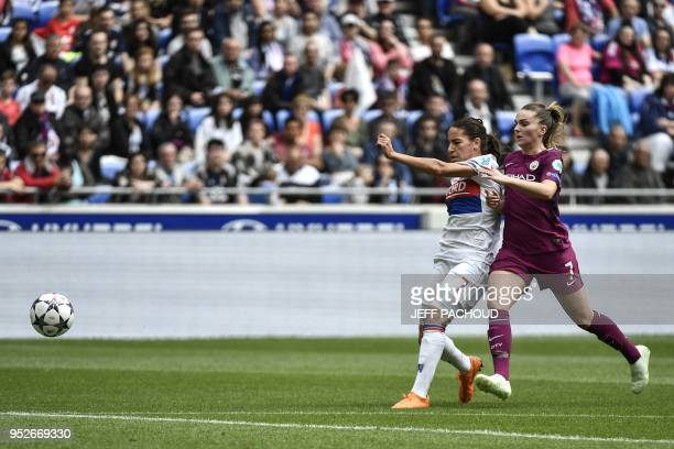 Manchester City's British forward Melissa Lawley vies with Lyon's French midfielder Amel Majri during the UEFA Women's Champions League semi-final...