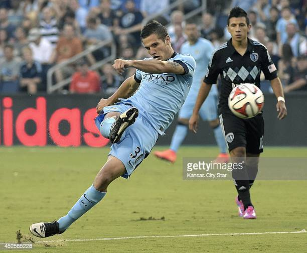 Manchester City's Bruno Zuculini scores the first goal of the game in the first half in front of Sporting KC's Mikey Lopez on Wednesday, July 23 at...
