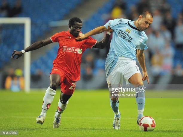 Manchester City's Bulgarian forward Martin Petrov vies with FC Midtjylland Nigerian midfielder Adigun Taofeek Salami during their UEFA Cup 2nd...