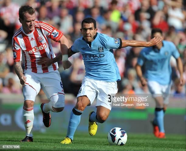 Manchester City's Carlos Tevez and Stoke City's Glenn Whelan battle for the ball