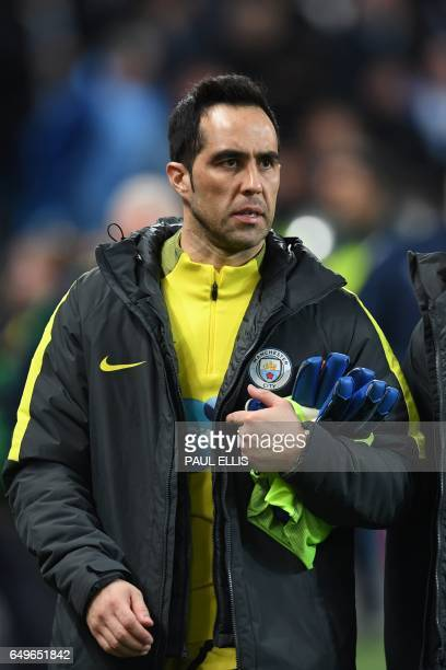 Manchester City's Chilean goalkeeper Claudio Bravo arrives to take his place on the bench for the English Premier League football match between...