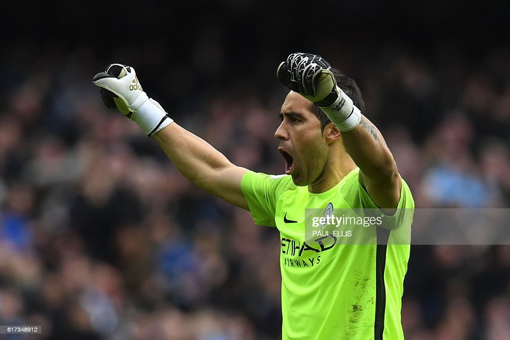 Manchester City's Chilean goalkeeper Claudio Bravo celebrates after City score their first goal during the English Premier League football match between Manchester City and Southampton at the Etihad Stadium in Manchester, north west England, on October 23, 2016. / AFP / Paul ELLIS / RESTRICTED TO EDITORIAL USE. No use with unauthorized audio, video, data, fixture lists, club/league logos or 'live' services. Online in-match use limited to 75 images, no video emulation. No use in betting, games or single club/league/player publications. /