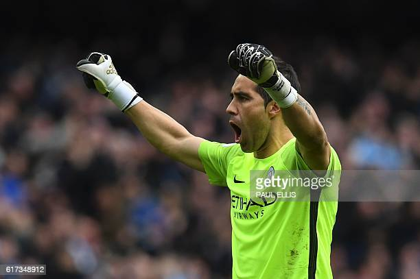 Manchester City's Chilean goalkeeper Claudio Bravo celebrates after City score their first goal during the English Premier League football match...