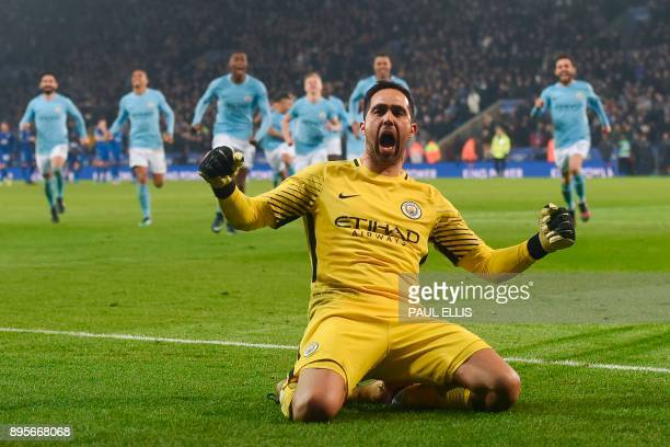 TOPSHOT Manchester City's Chilean goalkeeper Claudio Bravo celebrates after saving the final Leicester penalty to win the penalty shoot out after...