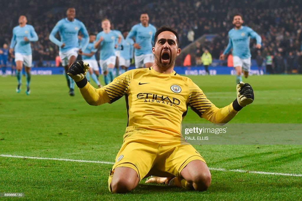 Manchester City's Chilean goalkeeper Claudio Bravo (C) celebrates after saving the final Leicester penalty to win the penalty shoot out after extra time during the English League Cup quarter-final football match between Leicester City and Manchester City at King Power Stadium in Leicester, central England on December 19, 2017. / AFP PHOTO / PAUL ELLIS / RESTRICTED TO EDITORIAL USE. No use with unauthorized audio, video, data, fixture lists, club/league logos or 'live' services. Online in-match use limited to 75 images, no video emulation. No use in betting, games or single club/league/player publications. /