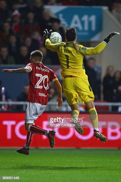 Manchester City's Chilean goalkeeper Claudio Bravo claims the ball under pressure from Bristol City's English midfielder Jamie Paterson during the...