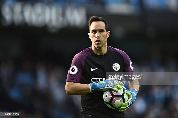 Manchester City's Chilean goalkeeper Claudio Bravo holds the ball during the English Premier League football match between Manchester City and...