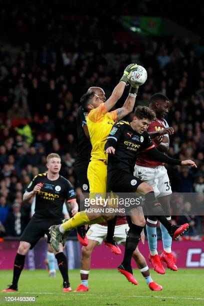 Manchester City's Chilean goalkeeper Claudio Bravo jumps to claim the ball during the English League Cup final football match between Aston Villa and...