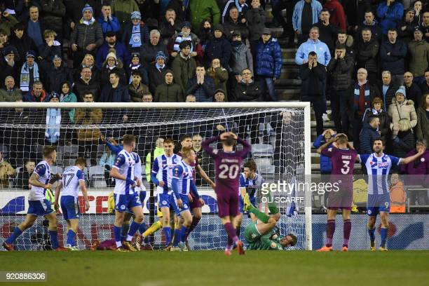 Manchester City's Chilean goalkeeper Claudio Bravo makes a final save during the English FA Cup fifth round football match between Wigan Athletic and...