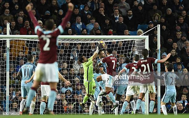 Manchester City's Chilean goalkeeper Claudio Bravo scrambles for the ball during a mele which resulted in a goal by Burnley's English defender Ben...