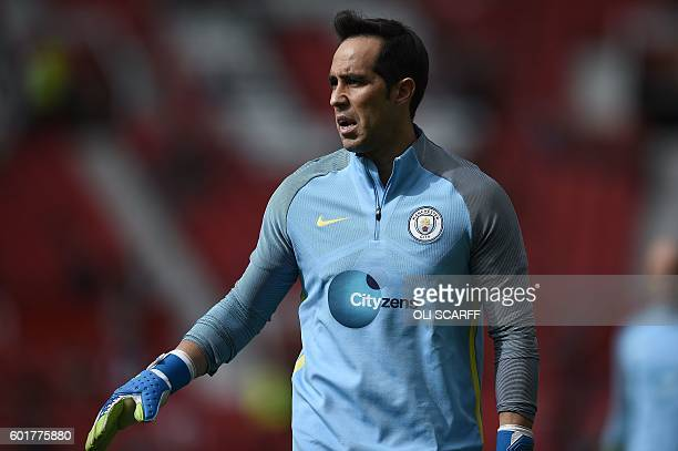 Manchester City's Chilean goalkeeper Claudio Bravo warms up ahead of the English Premier League football match between Manchester United and...