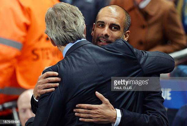 Manchester City's Chilean manager Manuel Pellegrini greets Bayern Munich's manager Pep Guardiola before the start of the UEFA Champions League group...