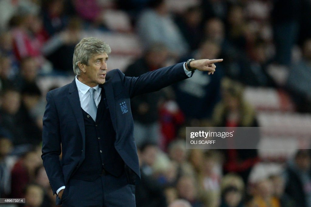 Manchester City's Chilean manager Manuel Pellegrini points from the touchline during the English League Cup third round football match between Sunderland and Manchester City at the Stadium of Light in Sunderland, northest England, on September 22, 2015. AFP PHOTO / OLI SCARFF USE. No use with unauthorized audio, video, data, fixture lists, club/league logos or 'live' services. Online in-match use limited to 75 images, no video emulation. No use in betting, games or single club/league/player publications. /