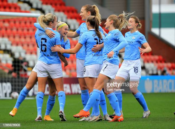 Manchester City's Chloe Kelly celebrates scoring during the Barclays FA Women's Super League match between Manchester United Women and Manchester...