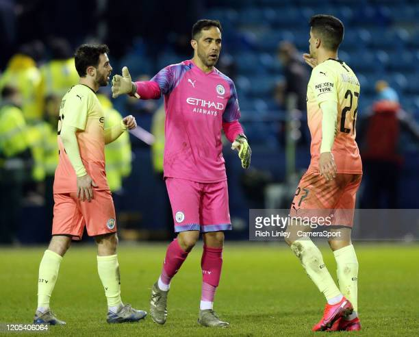 Manchester City's Claudio Bravo and Joao Cancelo celebrate at the final whistle during the FA Cup Fifth Round match between Sheffield Wednesday and...